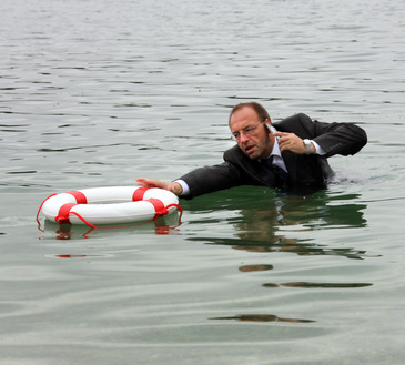 Manager greift nach Rettungsring